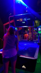 Air hockey - humans vs robots. Seemed impossible, until my girl stepped up to the rink.